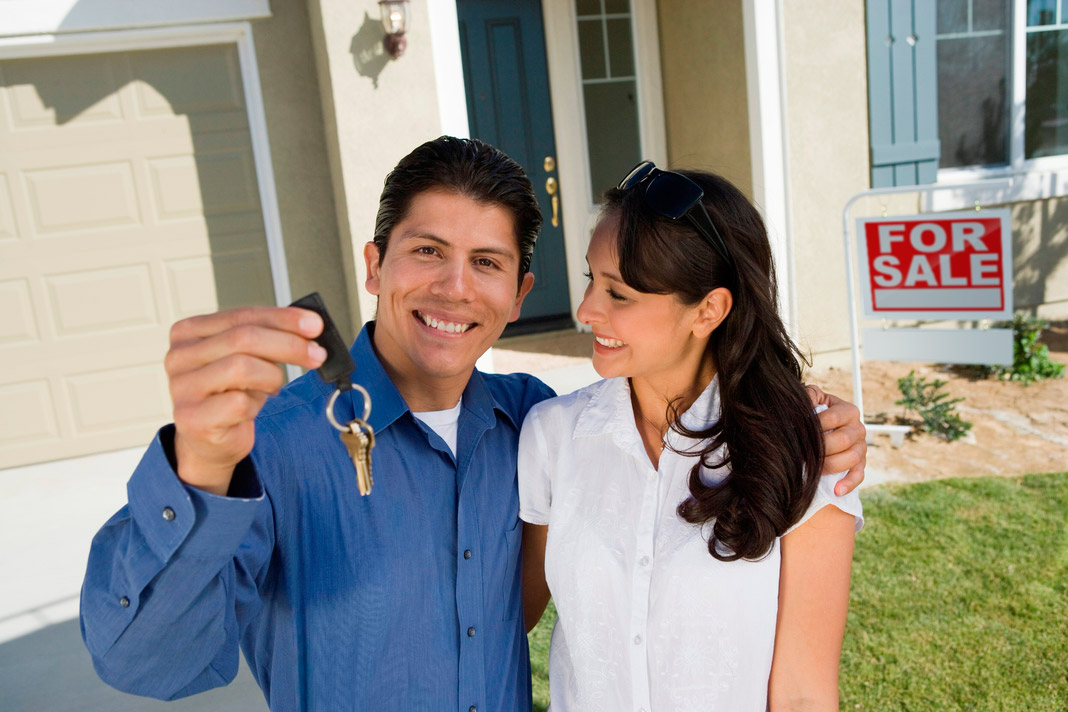 Couple with keys to new house